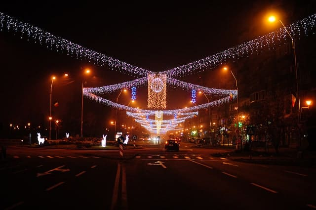 Road at night with Christmas lights over the top.